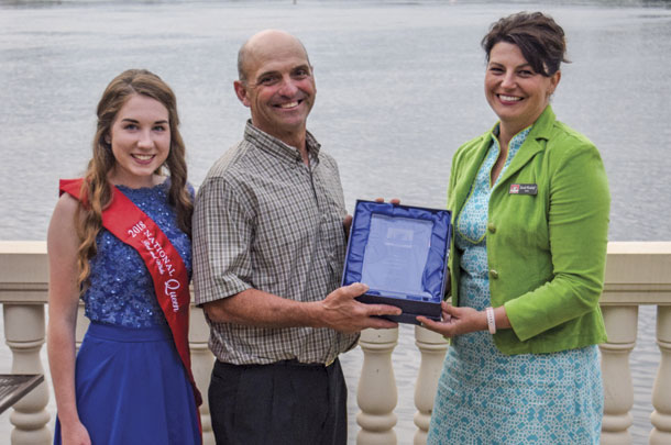 National Red and White Queen Present doug Lyons with Master Breeder Award