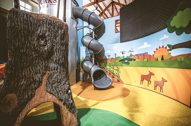 An interactive experience is an indoor two-story slide