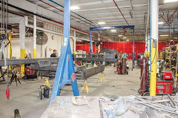 Pump trailers, hose reels and toolbars are assembled in a multitude of welding bays in the center of the facility