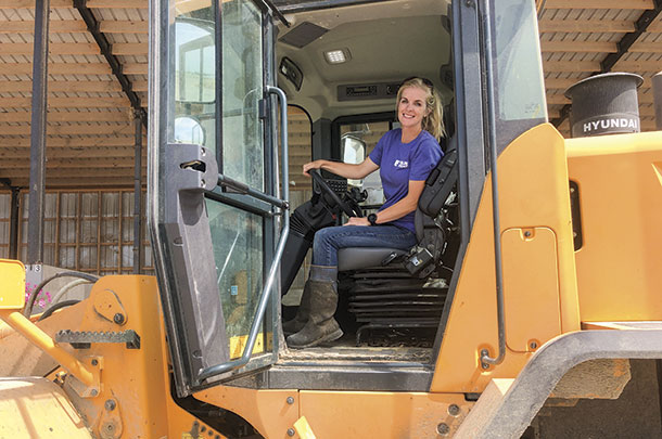 Renee Clark operates machinery.