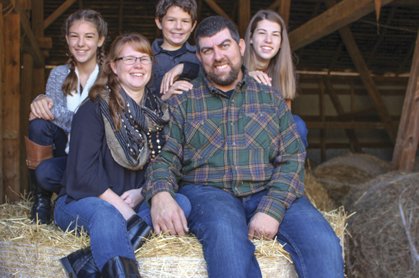 Shelby and Rich Holsopple have chosen to raise their three children on their dairy farm.