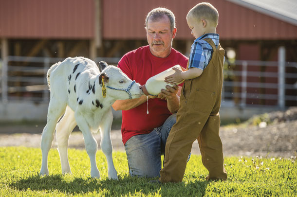 A Maryland dairy farmer helps his granson