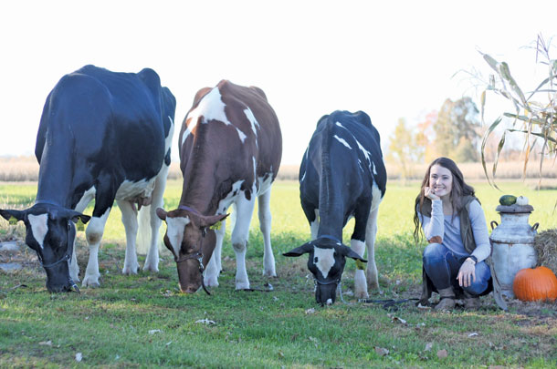 Brooke Hammann poses with her cattle